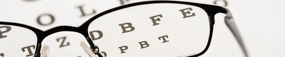 glasses on top of eye chart